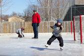 Family at a skating rink — Stock Photo