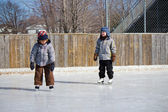 Children at the skating rink — Stock Photo