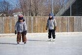 Children at the skating rink — Stock Photo