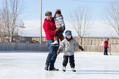 Happy family at the skating rink — Stock Photo