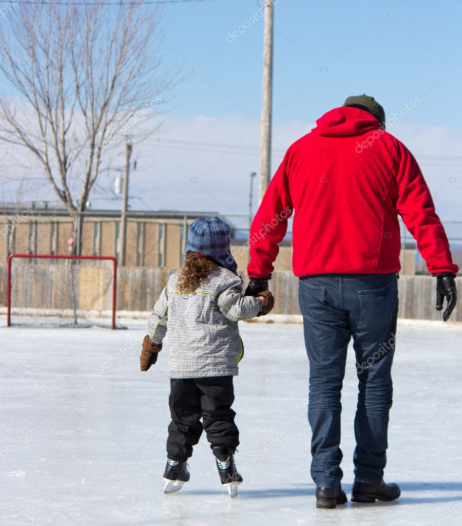 Father Teaching Daughter How To Ice Skate '�  Stock Photo #11115118