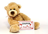 Teddy bear with hug coupon — Stock Photo