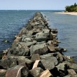 Rock pier on lake — Stock Photo