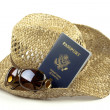 Stock Photo: Straw hat with glasses and passport