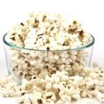 Popcorn in glass bowl — Stock Photo #11977383