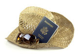 Straw hat with glasses and passport — Stock Photo