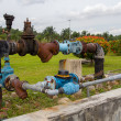 Stock Photo: Colorful rusting pipes and valves