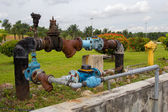 Colorful rusting pipes and valves — Stock Photo
