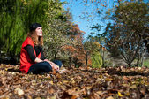 Sitting in autumn leaves — Stock Photo