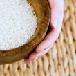 Wooden bowl of rice — Stock Photo