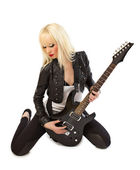 Beautiful blonde girl posing with black guitar — Stock Photo