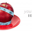 Stock Photo: Red apple and tape measure isolated on white (with sample text)