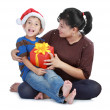 Boy in Santa Claus hat and his mom — Stock Photo
