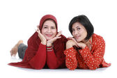 Muslim woman with her daughter lying — Stock Photo
