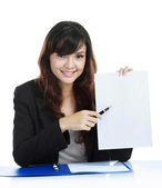 Businesswoman showing clipboard — Stock Photo