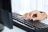 Hand typing on the computer keyboard — Stock Photo