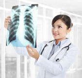 Female doctor looking at an x-ray — Stock Photo