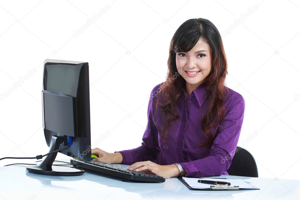 Portrait of a beautiful business woman working on her desk isolated on white background — Stock Photo #10755359