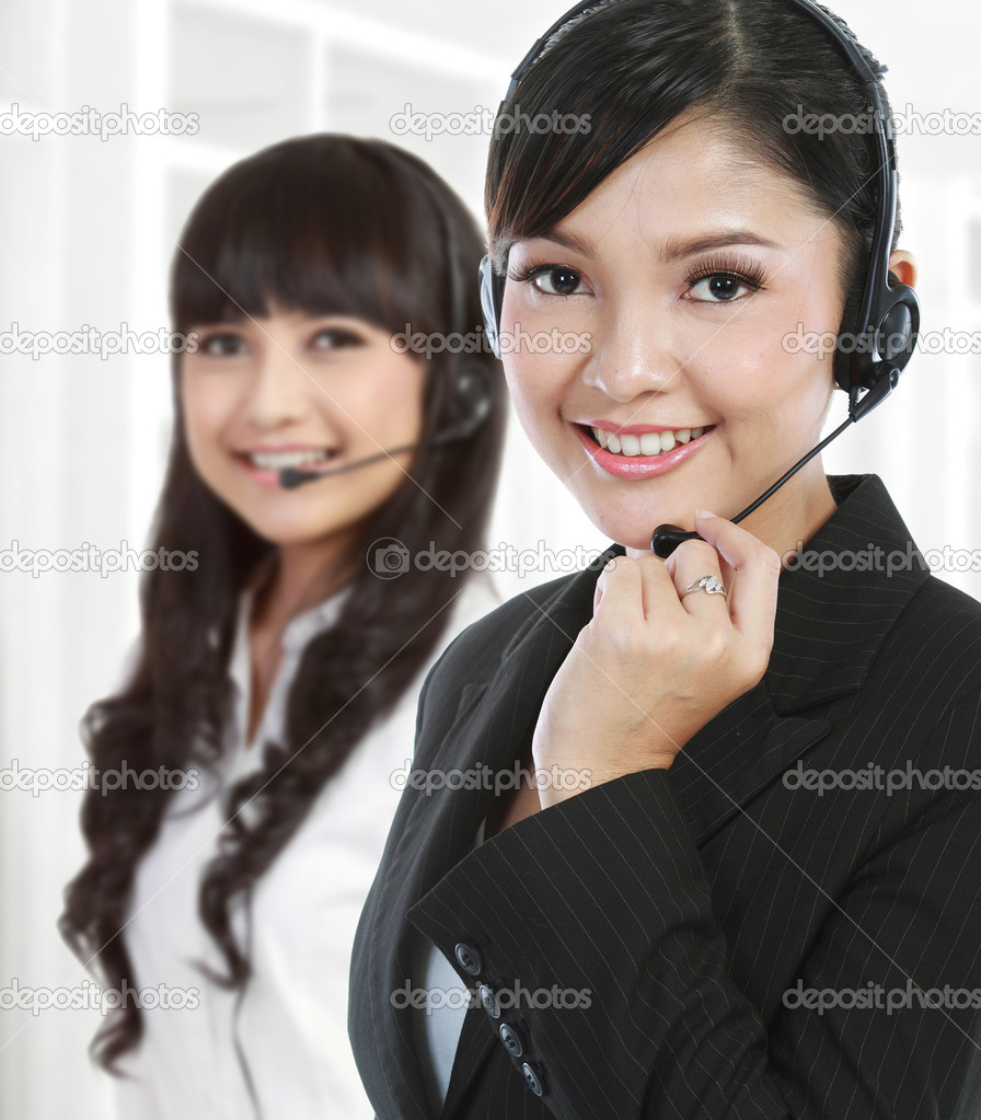 Portrait of a successful female call centre employee wearing a headset. in white background — Stock Photo #10755620