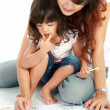 Mom and her little daughter drawing together — Stock Photo