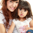 Smiling mom and daughter — Stock Photo