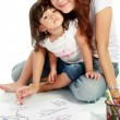 Mom and her little daughter drawing together — Stock Photo #10956431