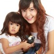 Smiling embracing mom and daughter — Stock Photo