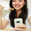 Texting message while having breakfast — Stock Photo #10956769