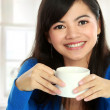 Asian woman having tea — Stock Photo