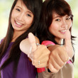 Asian girl showing thumb up — Stock Photo
