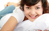 Young lady lying on the bed — Stock Photo