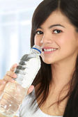 Woman with a bottle of water — Stock Photo