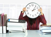 Woman with big clock covering — Stock Photo