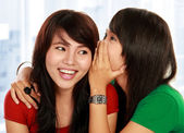 Two young woman sharing gossip — Stock Photo