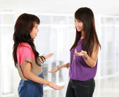 Two young woman talking — Stock Photo