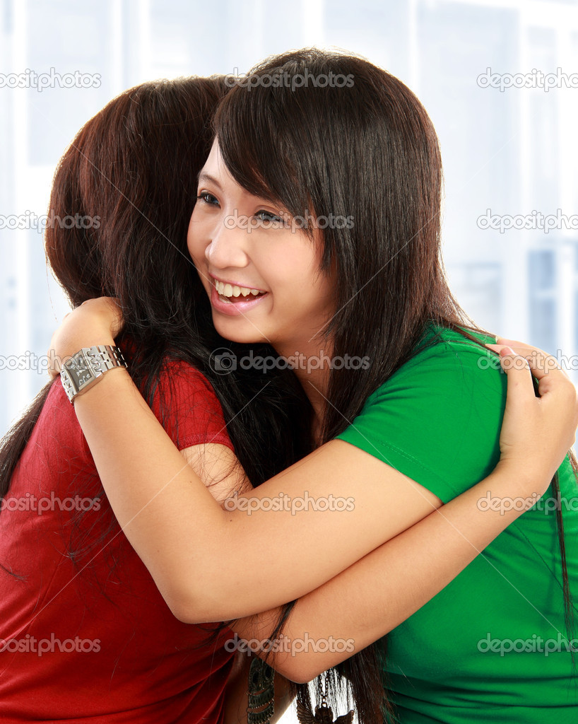 Happy asian women hugging each other and smiling — Stock Photo #10957661