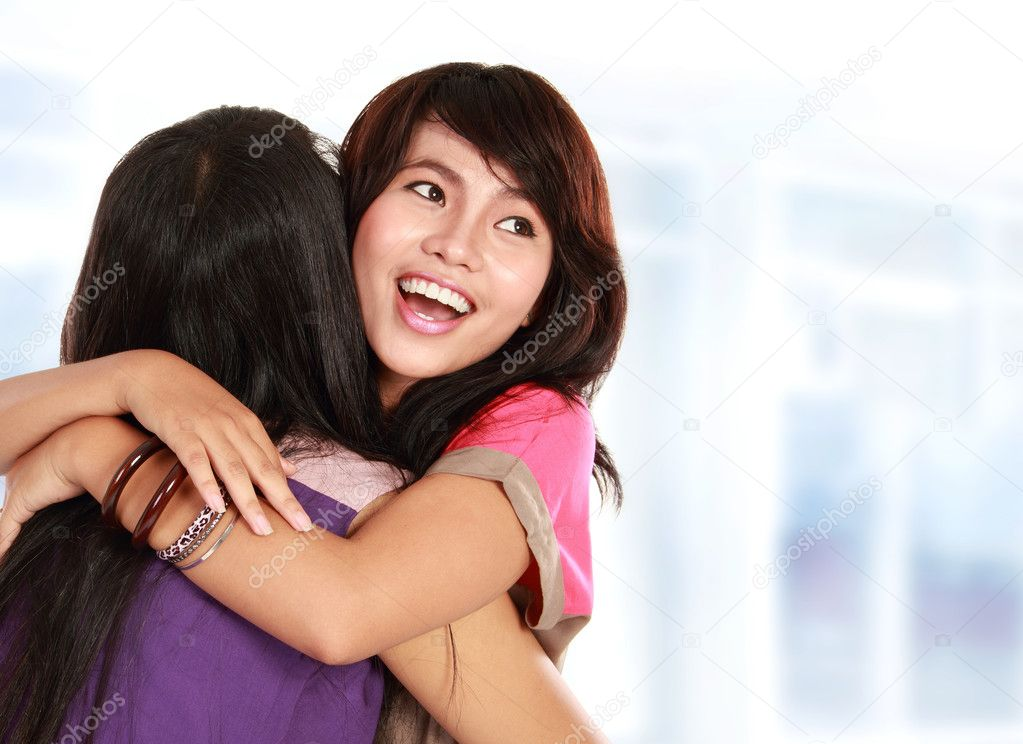 Happy asian women hugging each other and smiling — Stock Photo #10957936