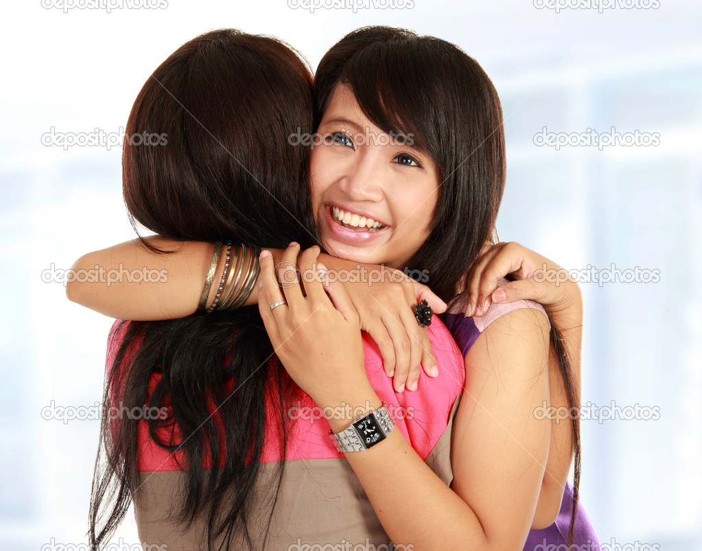 Happy asian women hugging each other and smiling — Stock Photo #10957960