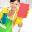 Woman cleaning windows — Stock Photo