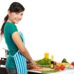 Beautiful woman cutting vegetables — Stock Photo