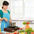 Woman cooking - Stock Photo