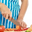Beautiful woman cutting vegetables — Stock Photo