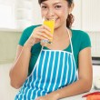 Woman having a glass of fresh juice — Stock Photo