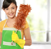 Woman with cleaning sweep — Stock Photo