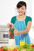 Woman making a fresh juice — Stock Photo