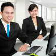 Royalty-Free Stock Photo: Smiling man and woman office worker