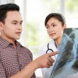 Female doctor with patient — Stock Photo