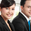 Man and woman office worker smiling — Stock Photo