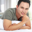 Man lying in bed smiling — Stock Photo #11146413