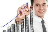 Businessman drawing a rising diagram — Stock Photo